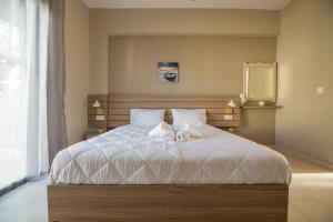 Letto o letti in una camera di Ilaeira rooms