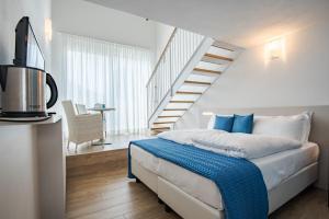 Een bed of bedden in een kamer bij Hotel Vischi