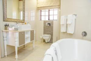 A bathroom at Ivory Manor Boutique Hotel
