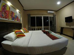 Un ou plusieurs lits dans un hébergement de l'établissement Sometime@Samoeng