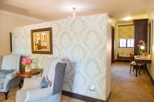 A seating area at Ivory Manor Boutique Hotel