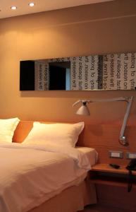 A bed or beds in a room at 1000 Colors Hotel
