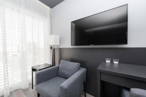 A television and/or entertainment centre at Artis accommodation