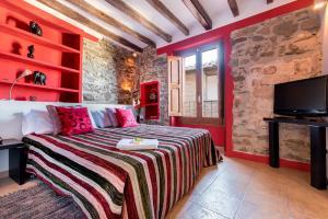 Cama o camas de una habitación en Hotel Cal Llop