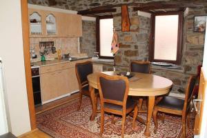 A kitchen or kitchenette at **ETNO Vila** - KRUSEVO