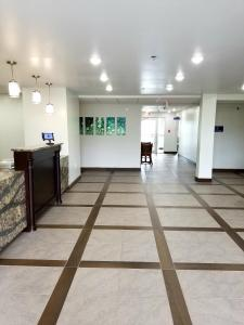 The lobby or reception area at Quality Inn & Suites Watertown Fort Drum