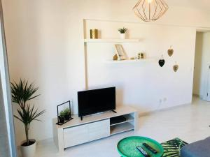 A television and/or entertainment center at Ferragudo'Spot