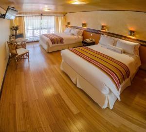 Un ou plusieurs lits dans un hébergement de l'établissement Hotel Taypikala Machupicchu