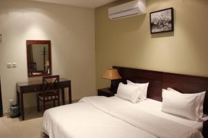 Cama ou camas em um quarto em Ray Kady Hotel Apartment 2