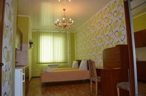 Кровать или кровати в номере SunLake Hotel Osokorki
