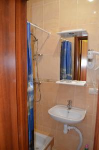 Ванная комната в SunLake Hotel Osokorki