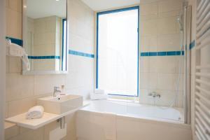 A bathroom at Les Terrasses d'Eze - Hôtel & Spa