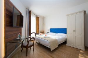 Un ou plusieurs lits dans un hébergement de l'établissement My Rooms Central Maria