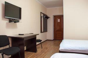 Телевизор и/или развлекательный центр в Гостиница Альтамира