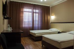 Кровать или кровати в номере Гостиница Альтамира