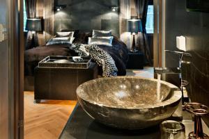 Een badkamer bij Herangtunet Boutique Hotel