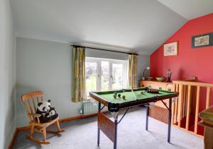 A pool table at 1 Tan yr Eglwys