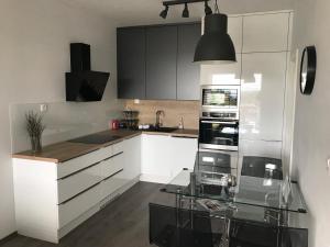 Kuchyňa alebo kuchynka v ubytovaní Greenbay Golf Apartments