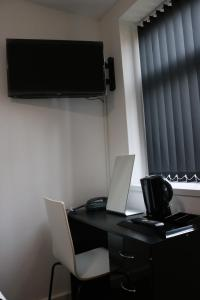 A television and/or entertainment center at Moorside Lodge