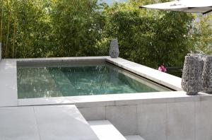 The swimming pool at or near Filario Hotel & Residences