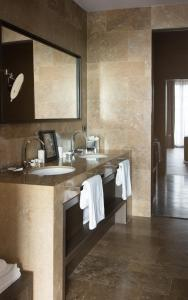 A bathroom at Filario Hotel & Residences