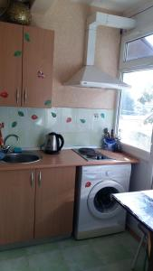 Кухня или мини-кухня в Apartment Чебрикова