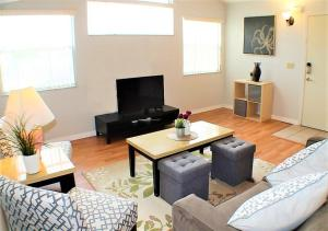 A television and/or entertainment centre at 2-Bedroom Cozy Condo Unit, 8 miles from Disney!