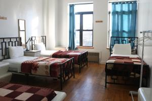 A bed or beds in a room at NY Moore Hostel