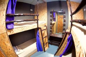 A bunk bed or bunk beds in a room at IRSIA BACKPACKERS GUESTHOUSE