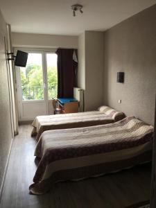 Un ou plusieurs lits dans un hébergement de l'établissement Firmhotel