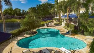 A view of the pool at Inn at Pelican Bay or nearby