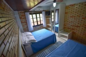 Cama ou camas em um quarto em Residencial Costa Mar