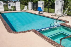 The swimming pool at or near Super 8 by Wyndham Kountze Big Thicket Nat'l Pres Area
