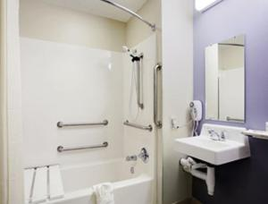 A bathroom at Microtel Inn and Suites DIA