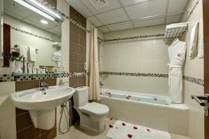 A bathroom at Rose Garden Hotel Apartments - Barsha