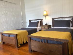 A bed or beds in a room at Five 3 Five