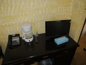 A television and/or entertainment center at Chinatown Hotel Chicago