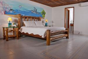 A bed or beds in a room at Hotel Punta Faro