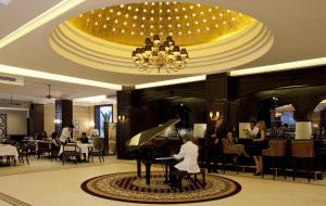 A restaurant or other place to eat at The Majestic Hotel Kuala Lumpur, Autograph Collection