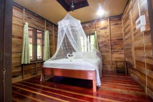A bed or beds in a room at Khao Sok Palmview Resort