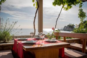 A restaurant or other place to eat at Poseydon Beach Bungalow