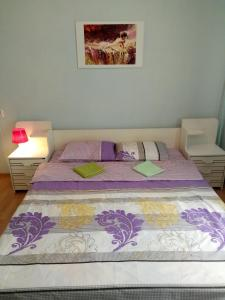 Кровать или кровати в номере Апартаменты на ул. Ленина