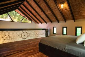A bed or beds in a room at Lua Villas