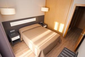 Cama o camas de una habitación en Apartahotel & Spa Jacetania
