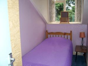 A bed or beds in a room at The Tops Self Catering
