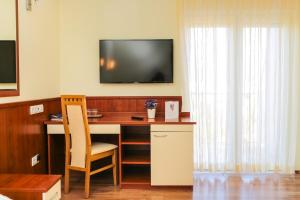 A television and/or entertainment centre at Hotel Merlot