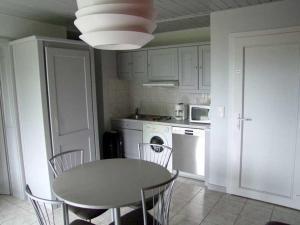 Cuisine ou kitchenette dans l'établissement L'Éden des Champs