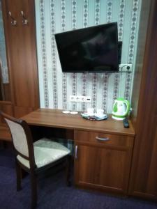 Телевизор и/или развлекательный центр в Мини-Отель Аска