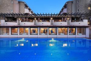 The swimming pool at or near Grand Hotel Smeraldo Beach