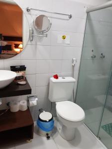 Um banheiro em Pousada Topázio